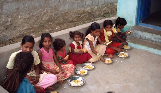 Girls eating dinner - India